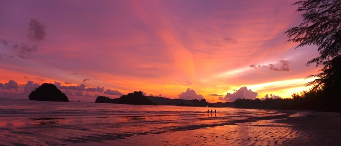 Retirees enjoying the sunset on the beach